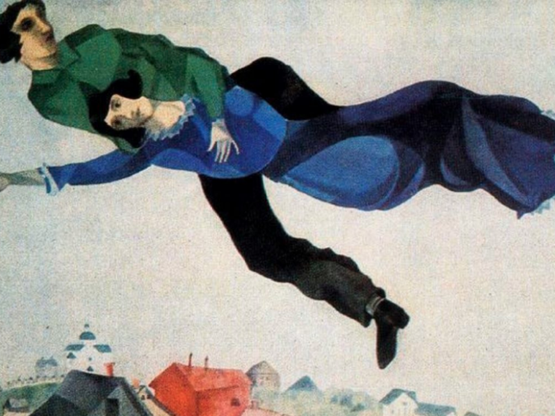 Chagall's painting of lovers flying through the sky over a town