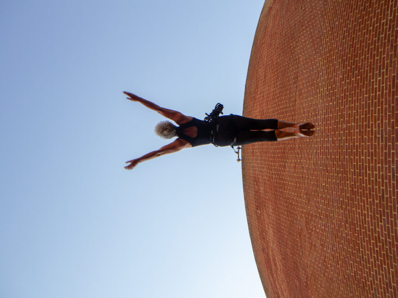 Dancer jumping on a wall